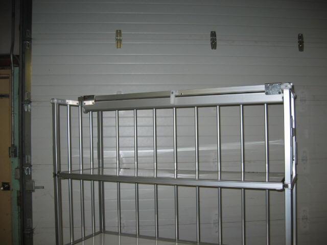 Hinged hanger retention open